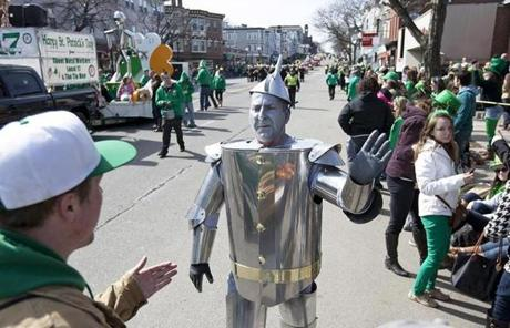 South Boston, MA - 3/17/2013 - Frederick Creager (cq), of the Sheet Metal Workers Local 17 dressed as a tin man gives high fives to people along East Broadway. The Annual St. Patrick's Day Parade makes its way through South Boston, MA on Sunday, March 17, 2013. The parade was followed by the Veterans for Peace parade. (Yoon S. Byun/Globe Staff) Slug: 18parade Reporter: n/a LOID: 5.1.1279310985