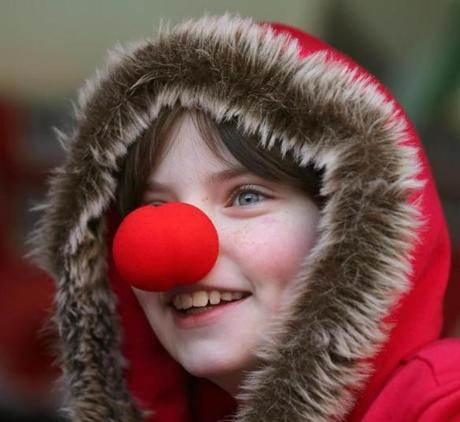BOSTON, MA. 03/ 18 /13:RED NOSED.... 4th grader Evie Kittredge ( her sister also had a nose photo ) from the Warren Prescott school LOTS OF RED COLD NOSES this morning with Boston having a low in the 20's degrees for these Boston School children at Boston City Hall Plaza on board vehicles from Boston Duck Tours who got some clown noses from the Big Apple Circus which opens next week. ( David L Ryan/Globe Staff Photo ) SECTION: METRO TOPIC stand alone photo