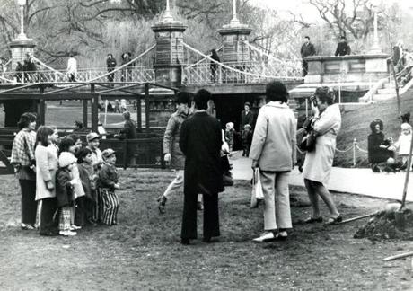 April 21, 1971: School vacation week drew crowds to the Public Garden for photo opportunities. Earth Week in Massachusetts started the next Sunday and you can see shovels and picks to the right in preparation for a big Public Garden planting.