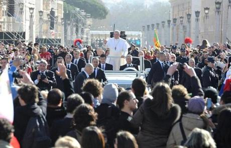 Pope Francis waved to the crowd from an open-air vehicle.