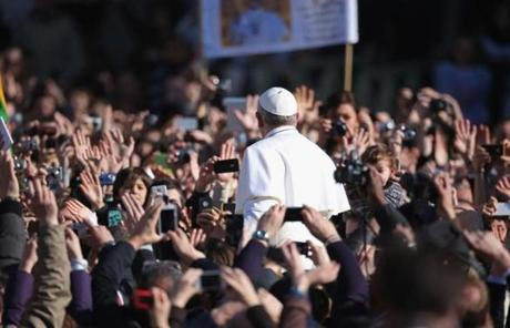 Many of the faithful took photos of Francis as he made his way through St. Peter's Square.