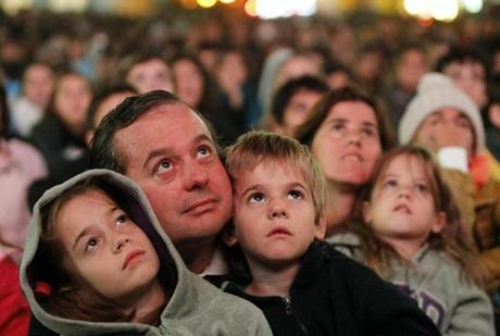 Families were among those who turned out in the pre-dawn hours to watch a broadcast of the Argentine pope's installation.