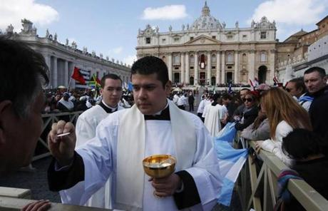A priest delivered communion to the faithful in St. Peter's Square.