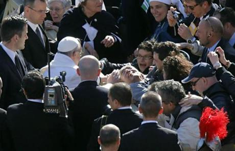 Pope Francis got out of his vehicle to bless a disabled man prior to the Mass.