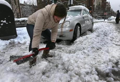 BOSTON, MA. 03/ 19 /13: THE LAST STRAW....Olivia Kelly ( cq) shovels out her stuck car with a window scrapper ( had no shovel ) on Commonwealth Avenue to keep her MUST dentist appointment. ANOTHER STORM hits the Boston area just before Spring is to start. ( David L Ryan/Globe Staff Photo ) SECTION: METRO TOPIC 20snowphoto
