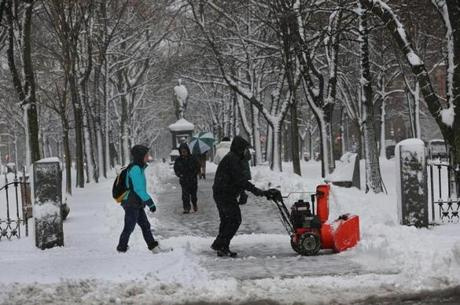 A snowblower helped to clear a path near Arlington Street and Commonwealth Avenue in Boston.