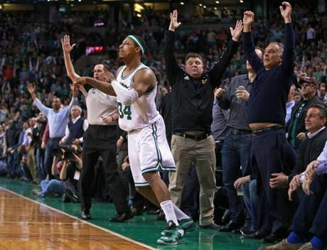 3/18/13: Boston, MA: A referee (as well as numerousd fans) signal that a second quarter three pointer by Celtics captain Paul Pierce (34) is good, and the shot put Boston ahead 52-38. The Boston Celtics hosted the Miami Heat in a regular season NBA basketball game at the TD Garden. (Jim Davis/Globe Staff) section:sports topic:Heat-Celtics