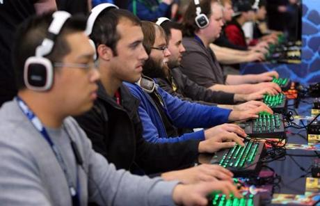 "Attendees play ""Dungeon Defenders 2"" at the Boston Convention and Exhibition Center."