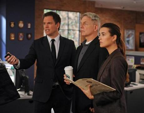 "Michael Weatherly, Mark Harmon, and Cote de Pablo in ""NCIS."""