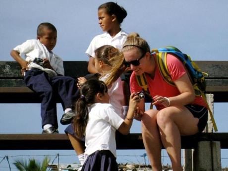 Our Journey for Hope cofounder Becca Laders works with children in the village of Flores, Honduras.
