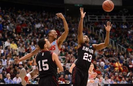 Wesley Saunders (right) went for the loose ball against New Mexico's Chad Adams.