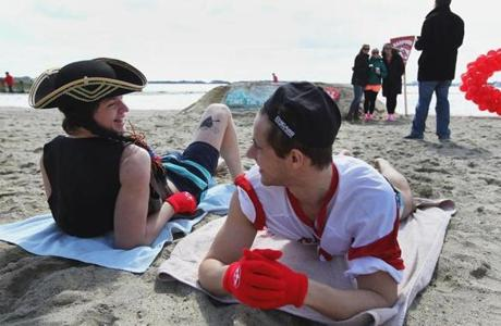 South Boston, MA 032313 Boston University students Jean Gervoson (cq), dressed as a pirate, and Jordan Munck (cq), who posed as a cheerleader, waited for the Cupid Splash event to kick off at M Street Beach in South Boston, Saturday, March 23 2013. One hundred fifty hardy souls plunged into the waters to raise money for Save the Harbor and Save the Bay. (Staff Photo/Wendy Maeda) section: Metro slug: 24cupidsplash reporter: In-Cap