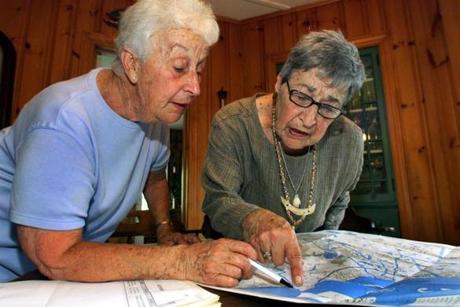 Sisters Alba Thompson (left) and Marie Fehlow studied a tourist map of Plymouth.