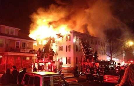 The fire was at times heavy, with flames pouring out of the building's windows and consuming the building's roof.