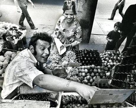 August 11, 1972: Donna Bossi of East Boston buys fruit from William Bondanza of the North End at his Winter Street fruit stand.