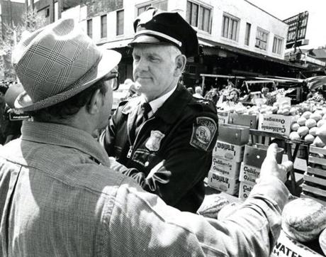 May 10, 1980: Joe Matera, president of the Haymarket Pushcart Association, argued with Capt. Richard Leary of District 1 after police arrested several Haymarket vendors. Three peddlers whose watermelon stand allegedly was blocking a fire land on North St, were arrested.