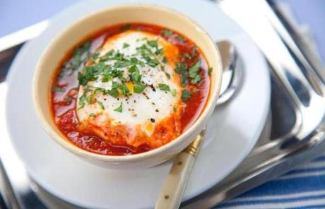 Shakshuka made with eggs poached in tomato sauce.