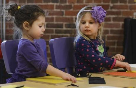 Three-year-old museum goers Annabelle Gomes (left), of Topsfield, and Grace Whitney, of Middleton, play in the Art Studio this month.