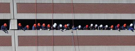 Firefighters from all over the Boston area got instructions on March 26 from the Massachusetts Firefighting Academy on how to rappel. It was a four day event hosted by the Quincy Fire Department at a Quincy parking garage.