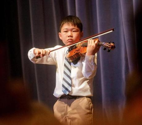 Violinist Austin Kwoun of Belmont, a seventh grader at the Fenn School in Concord, earned first place in the Ellen Huff Powers Young Artist Competition at Powers Music School in Belmont on March 3, playing the Mendelssohn Concerto in E Minor.