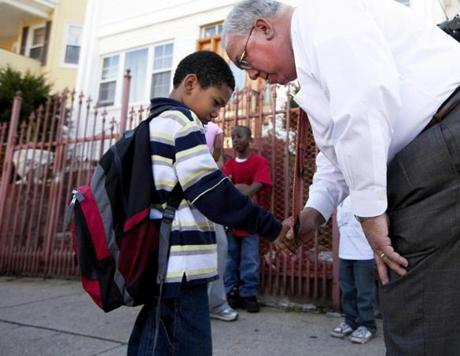 During his tenure, Thomas M. Menino spoke some comforting words to a Mattapan's Edrei Olivero during a neighborhood walkthough.