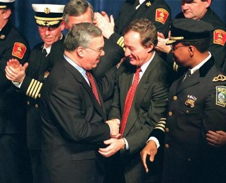Menino shook hands with Boston Police Commissioner Paul Evans after Menino delivered his State of the City Address Jan. 14, 1997.