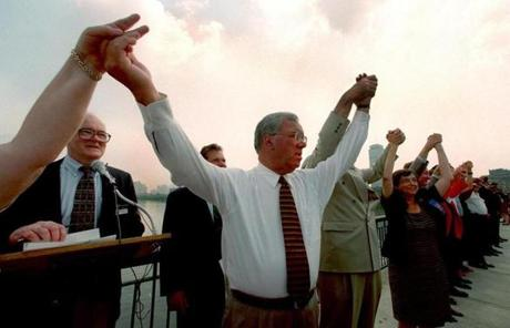 Menino and officials from other local communities held hands on the Massachusetts Avenue bridge Aug. 6, 1996 as part of National Night Out.