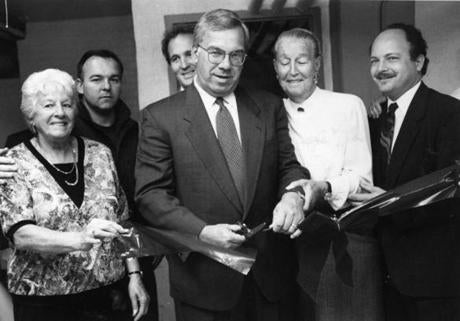 Menino cuts the ribbon at the opening of the Mary Ellen McCormack housing project's senior center Oct. 14, 1993. McCormack residents worked for eight years to get a place for seniors.