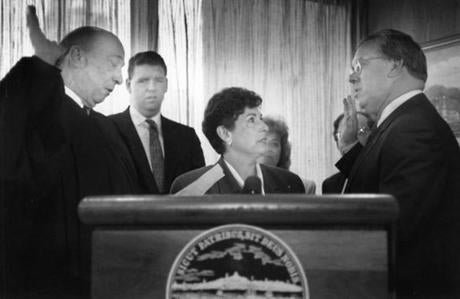 Judge Paul Lipcos swore Menino in as mayor of Boston Nov. 16, 1993 as Menino's wife, Angela, looked on.