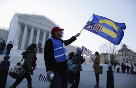 Marcos Garcia held flags on the steps of the US Supreme Court.