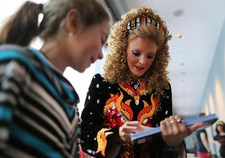 The reigning world champion, Irish dancer Claire Greaney, autographed a program for Maggie Fleming, 9, (left) from Islip, N.Y.