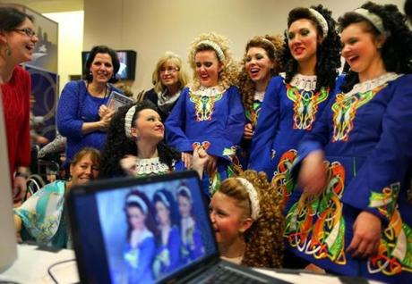 Dancers from the Coyle School of Irish Dance in Philadelphia laughed as they looked at photos of themselves on a computer.