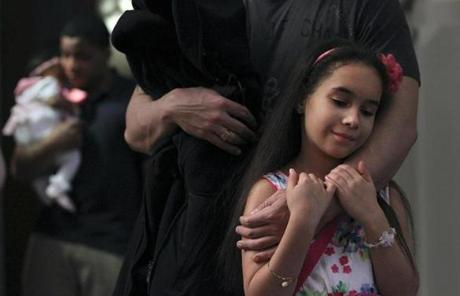 Emily Roman, 10, of South Boston stood in the back with her father.