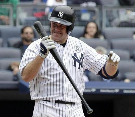 Kevin Youkillis reacted after striking out to end the Yankees' seventh inning.