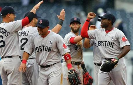 The Red Sox celebrated after beating the Yankees Monday in their 2013 season opener.
