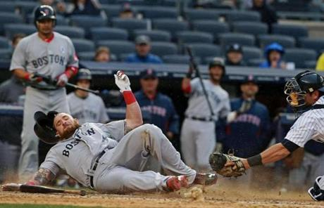 Jonny Gomes slid in safely in the ninth inning as the Red Sox extended their lead.