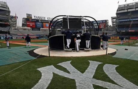 Players milled about the batting cage Monday morning ahead of the Opening Day matchup between the Red Sox and Yankees.