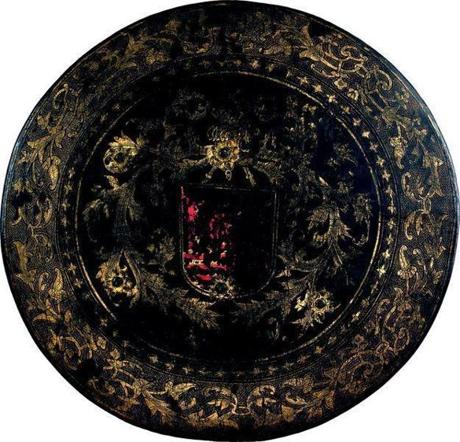 A 16th-century Mughal-style lacquered shield with gold leaf, oil paint.