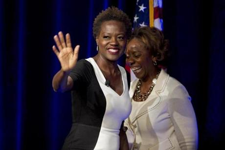 Boston, MA - 4/2/2013 - Award-winning actress Viola Davis (cq) comes to the stage after being introduced by Jackie Glenn (cq) of EMC. The Simmons Leadership Conference takes place at the Seaport World Trade Center in Boston, MA on Tuesday, April 2, 2013. (Yoon S. Byun/Globe Staff) Slug: simmonsleadershipconference Reporter: shanahan LOID: 6.1.1645205286