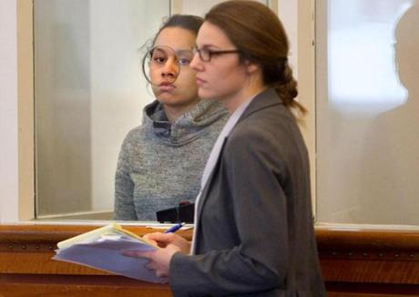 Samia Jones struck a defiant pose at her arraignment Tuesday in Dorchester District Court on assault charges.