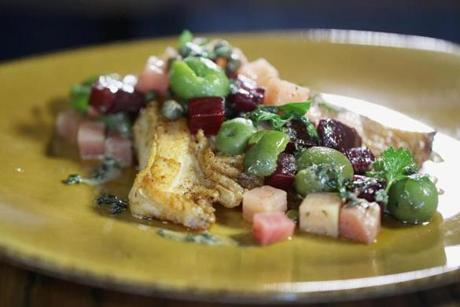 Skate on the bone with lemon, capers, and diced red beets.