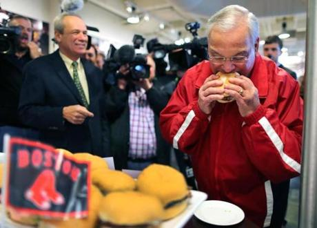 Boston mayor Thomas Menino stopped by to check out the Red Sox' new menu offerings with team president Larry Lucchino, left.