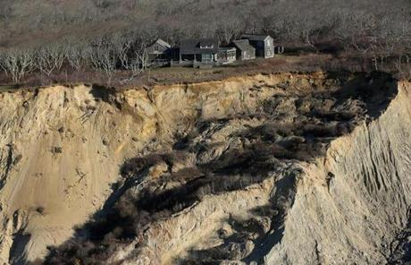 Erosion is threatening several homes on Chappaquiddick, a problem associated with climate change.