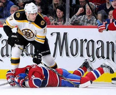 Milan Lucic checks Tomas Plekanec of the Canadiens on Saturday.