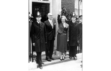 Thatcher waved as she arrived to take office at 10 Downing Street in London with her husband, Denis.