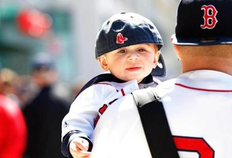 A young fan was decked out in Red Sox garb on Monday.