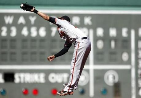 Manny Machado leaped to rob Shane Victorino of a hit in the first inning.