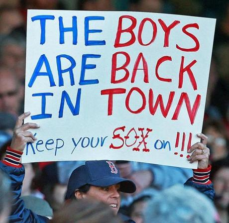 4/8/13: Boston, MA: A fan welcomes the Red Sox back during the game. The Boston Red Sox hosted the Baltimore Orioles in an MLB game in their Home Opener at Fenway Park. (Jim Davis/Globe Staff) section:sports topic: Red Sox-Orioles