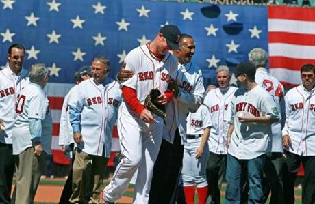 Jon Lester, center, and Jim Rice, to right of Lester, were among the first pitch participants.