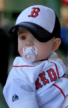 BOSTON, MA. 04/ 08 /13: ALL RED SOX deked out is 7 mos old Blake Adams from Charlestown at Opening Day for the Red Sox at Fenway Park who played against the Orioles ( David L Ryan/Globe Staff Photo ) SECTION: SPORTS TOPIC Red Sox-Orioles(1)